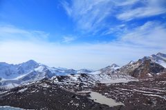 Glacial lake. On a background of mountain peak stock photography