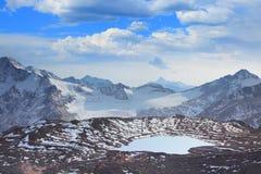 Glacial lake. On a background of mountain peak royalty free stock photo