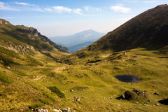 Glacial lake in the Carpathian Mountains. Great landscape of a beautiful glacial lake on a valley in the Carpathian Mountains during autumn season Stock Image