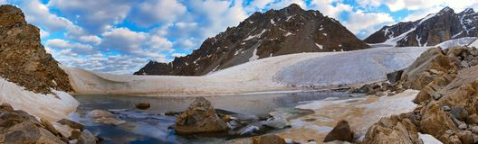 Glacial lake in the Caucasus 2. The glaciers are melting in summer, forming streams and lakes Stock Photos