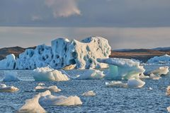 Glacial lake with icebergs. Glacial lagoon Jokulsarlon with floating icebergs in the lake stock photography