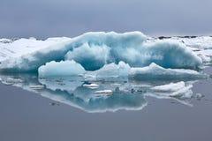 Glacial lake in Iceland. Glacial lake in Jokulsarlon, Iceland, icebergs floating in the pristine water stock image