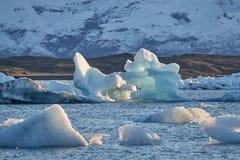 Glacial lake with icebergs. Glacial lake in Jokulsarlon landing between floating icebergs stock photography