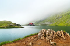 Glacial lake misty morning.The Balea Glacial Lake on Fagaras ,Romania. Sample royalty free stock photos