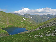 Glacial lake on a mountain Stock Photo