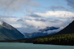Glacial lake and mountain forest on sparking summer day Alaska Stock Images