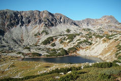 Glacial lake in mountains stock photos
