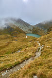Glacial lake in the mountains Stock Photo