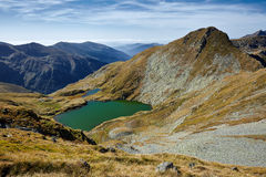 Glacial lake between mountains Royalty Free Stock Image