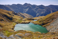 Glacial lake between mountains Stock Images