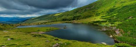 Glacial Lake Panorama. A panorama of the glacial lake Izvorul Bistritei Aurii in Rodnei mountains, Romania stock image