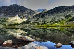 The glacial lake in Rila. The glacial lake in the Rila (bulgarian mountains royalty free stock photography