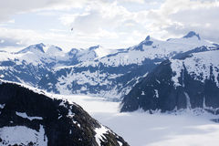 Glacial lake surrounded by mountains Stock Photography