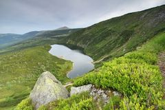 Glacial lake Wielky Staw. In Krkonose mountains in Poland and Snezka mountain in Czech republic Royalty Free Stock Images