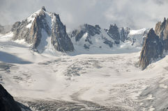 Glacial landscape. The tour ronde (l) and the mont blanc de tacul (r) above thevallee blanche on the Mont Blanc above chamonix in the french alps. The tiny cable Stock Photo