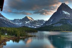Dusk at Swiftcurrent Lake, Glacier National Park, Montana, USA royalty free stock images