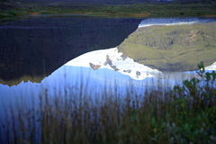 Glacial reflection. Svinafellsjokull glacial reflection in water Iceland Royalty Free Stock Photos