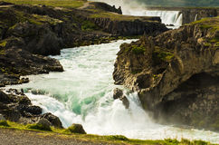 Glacial river with Godafoss waterfall in background, Iceland Stock Photography