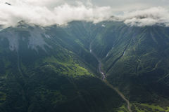 Glacial river between the hills. South Kamchatka Nature Park. Stock Images
