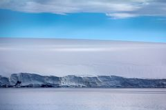 Glacial shield of George Land and Hayes Island. Islands along British channel. Glaciers, icefall, outlet glacier, snowfields and rock outcrops. Glacial shield stock image