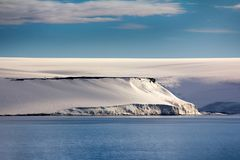 Glacial shield of George Land and Hayes Island. Islands along British channel. Glaciers, icefall, outlet glacier, snowfields and rock outcrops. Glacial shield of stock image