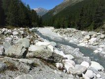 Glacial stream through a valley near Arolla, Switzerland. Glacial stream through boulders in an alpine valley near Arolla, Switzerland royalty free stock photography