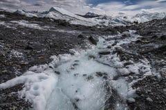 Glacial Stream. A river of glacial melt water flows from Matanuska Glacier in Alaska Stock Photo