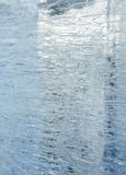 Glacial transparent block of ice with patterns. Stock Photo