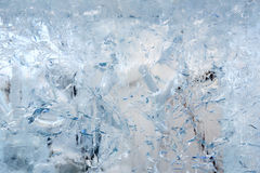 Glacial transparent block of ice with patterns. Royalty Free Stock Images