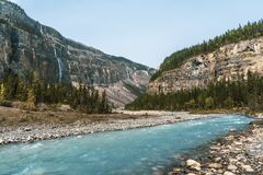 Glacial turquoise river with mountains