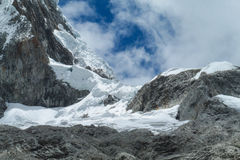 Glaciar covering mountain peaks of Andes Stock Photo