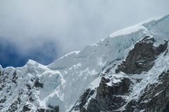 Glaciar covering mountain peaks of Andes royalty free stock image