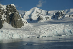 Glaciated mountains and icefall with blue sky. Lemaire Channel,Antarctica Stock Photography