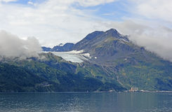 Glacier above a Coastal Town Royalty Free Stock Photography