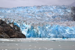 Glacier in Alaska. Sawyer Glacier, with its blue ices, at the end of Tracy Arm's fiord , southeast Alaska stock photos
