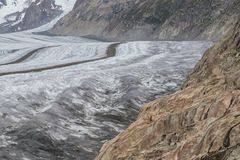 Glacier Aletsch surface with crevasses and rocks Royalty Free Stock Photos