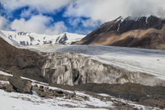 Glacier on a background of mountains and blue sky Royalty Free Stock Photography