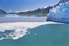 Glacier Bay. Ice and debris from a calving glacier dot scenic Glacier Bay in Alaska stock image