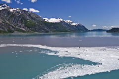 Glacier Bay Passage. Ice and debris from calving glaciers colors the water in Alaska's Glacier Bay Stock Images