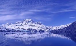 Glacier Bay Reflections. Reflections of mountains and a glacier.  Shot in Glacier Bay, Alaska Royalty Free Stock Photography