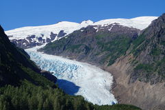 Glacier. A Beautiful Glacier,on a blue bird day, surrounded by mountains and forest Royalty Free Stock Photography