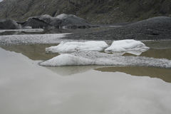 Glacier with black lava ice melting in lake royalty free stock photos