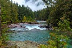 Glacier Blue River. Colorful rocks in a river in Glacier National Park, Montana Stock Photos