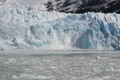 Glacier breaking, Argentina. Ice breaking off glacier in Los Glaciares National Park, Calafate, Patagonia, Argentina Royalty Free Stock Images
