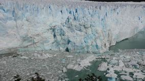 Glacier Chile los Glaciares with pure water lake. And many small ice bergs in summer stock footage