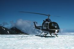 Glacier Chopper. A helicopter perches on the edge of a glacier on the south island of New Zealand in 1983 Royalty Free Stock Photography