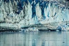 Glacier close-up. Landscape photo of glacier closeup with the glacier reflected in the icy water Royalty Free Stock Images