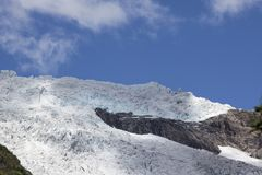 Glacier with clouds - blue sky Stock Image
