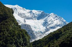 Glacier Covered Mountain Peak in New Zealand. Snow covered Rob Roy Peak in New Zealand`s Mt. Aspiring National Park Royalty Free Stock Image
