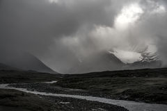 Glacier covered in sun lighted mist in river landscape black and white, Sweden. Trekking through Sarek national park is a awesome experience. Beautiful nature royalty free stock photography